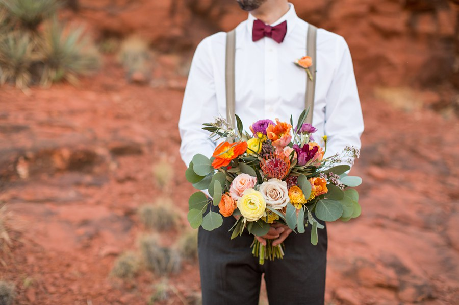 Northern AZ Wedding Ideas: Red Rock Country: Red Rock Country: Red Rock Country Groom Holding Flowers