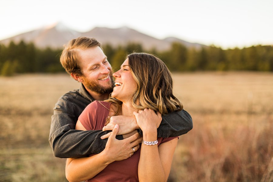 Natalia and Sean: Downtown Flagstaff AZ Engagement Photographer laughter