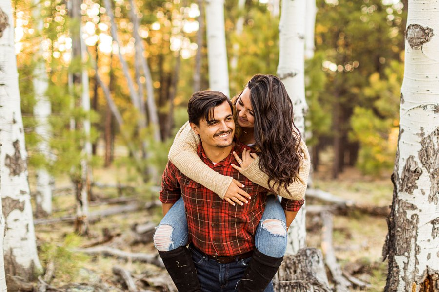 Brianna and John: Adventure Engagement Flagstaff Arizona piggy back