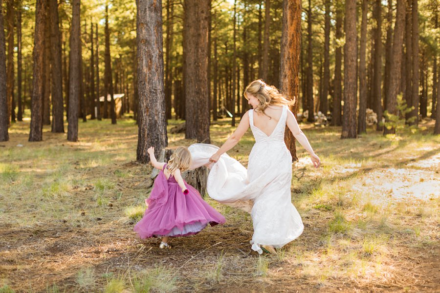 Becca and Josh: Northern AZ Wedding Photographer bride and flower girl candid