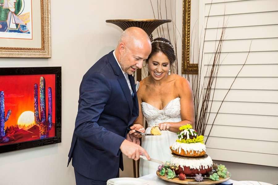 Liz and Jeremy: Phoenix Wedding Photography cutting the bundt cake