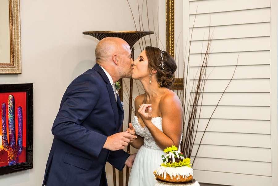 Liz and Jeremy: Phoenix Wedding Photography cake cutting and kisses