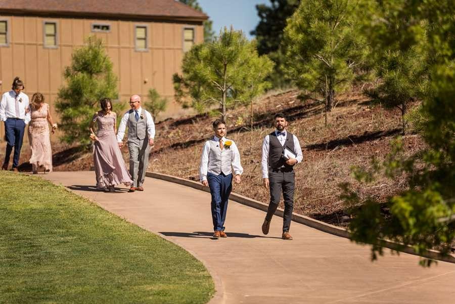 Trish and Mike: Downtown Northern Arizona Elopement groom walking