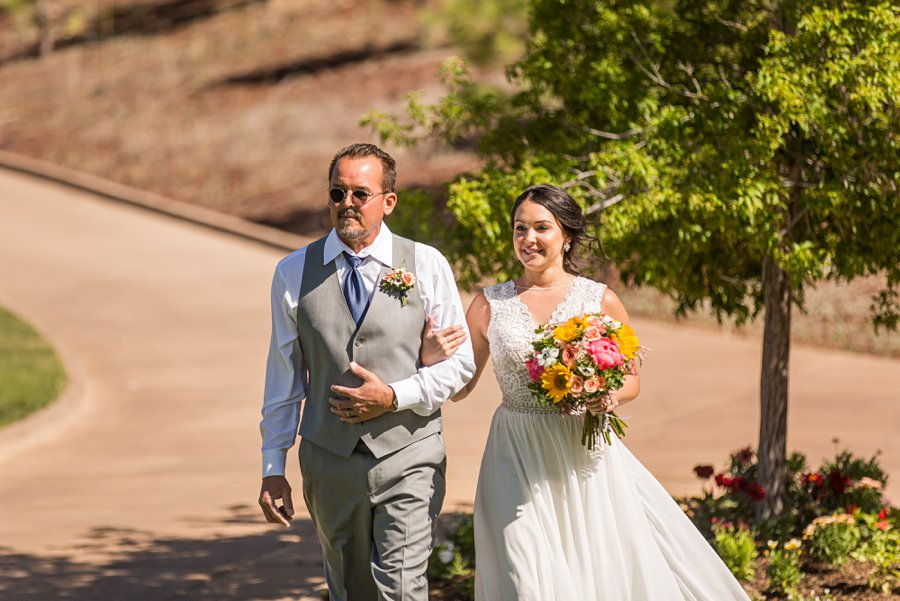Trish and Mike: Downtown Northern Arizona Elopement walking down the aisle
