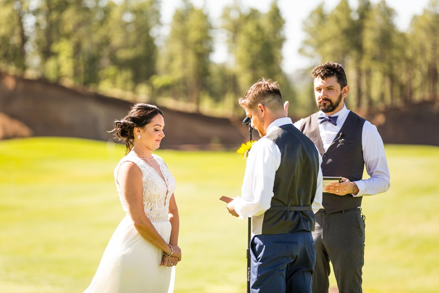 Trish and Mike: Downtown Northern Arizona Elopement reading vows together