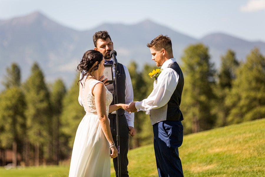 Trish and Mike: Downtown Northern Arizona Elopement exchanging rings