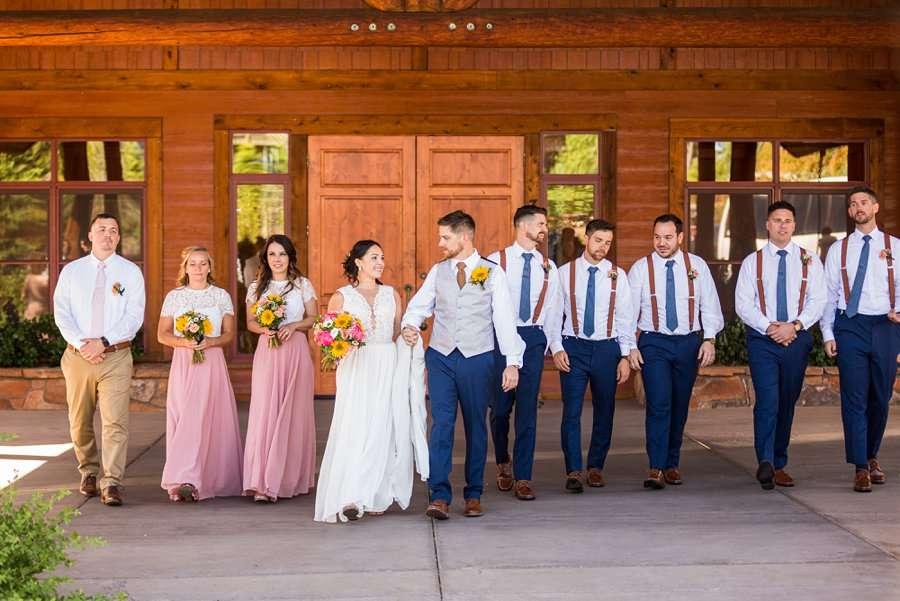 Trish and Mike: Downtown Northern Arizona Elopement bridal party walking shot