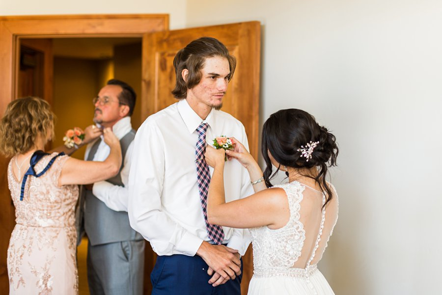 Trish and Mike: Downtown Northern Arizona Elopement pinning the flowers