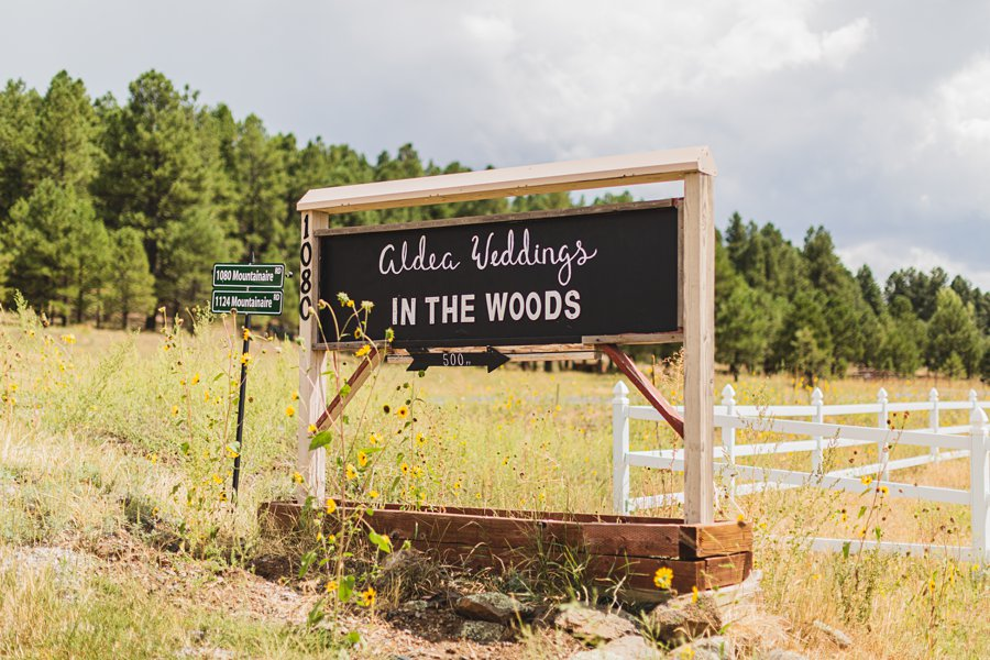 Aldea Weddings in the Woods: Styled Shoot outdoor sign in mountanniare
