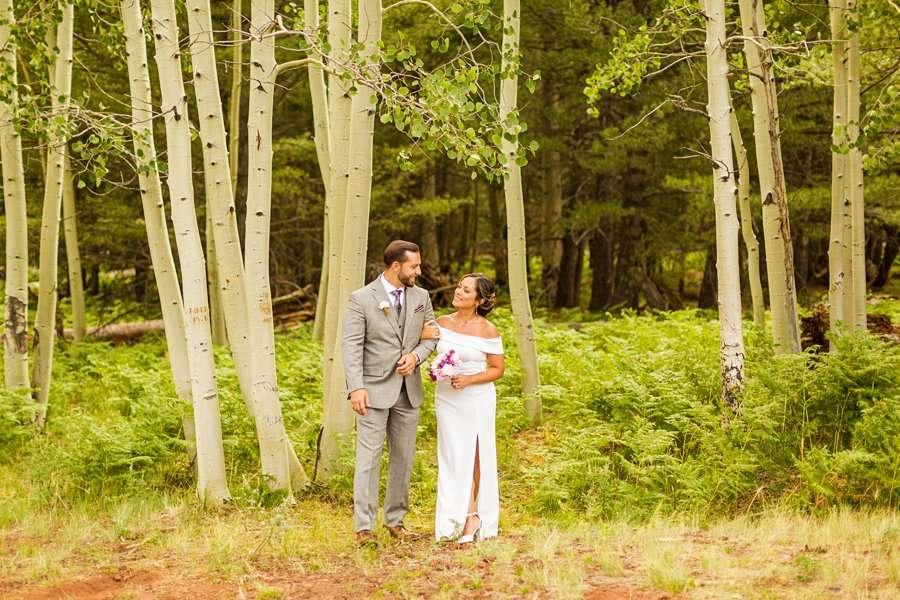 Jeanne-Marie and Rami: Aspen Corner Flagstaff Elopement couple walking in the woods