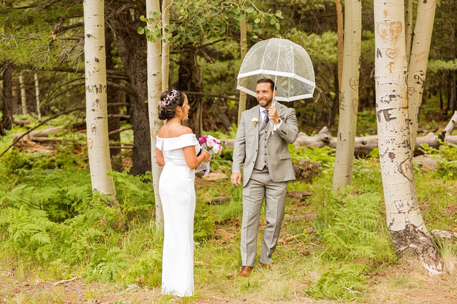 Jeanne-Marie and Rami: Aspen Corner Flagstaff Elopement bride and groom first look in the forest Aspen Corner Flagstaff Elopement