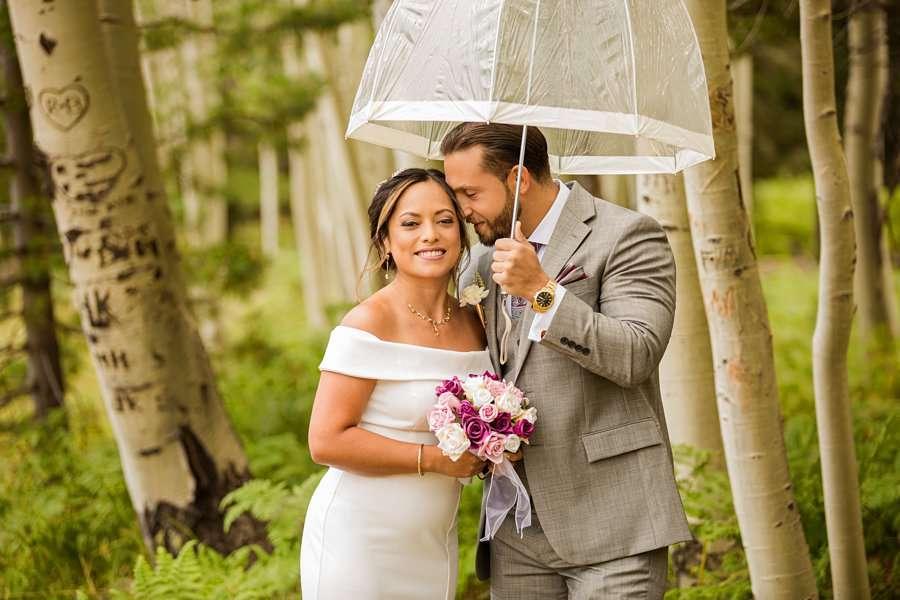 Jeanne-Marie and Rami: Aspen Corner Flagstaff Elopement snuggling in the rain