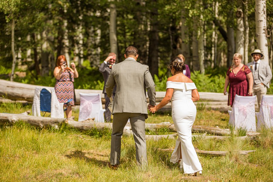 Jeanne-Marie and Rami: Flagstaff Snowbowl Wedding couple walking down the aisle