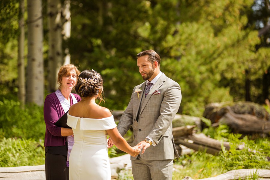 Jeanne-Marie and Rami: Arizona Mountains Wedding holding hands