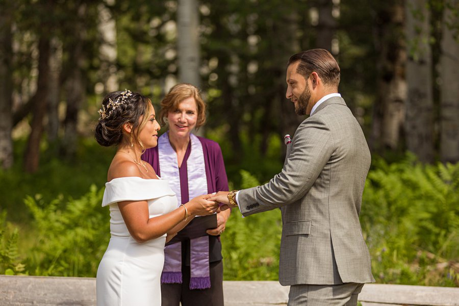 Jeanne-Marie and Rami: Flagstaff Snowbowl Wedding exchanging rings