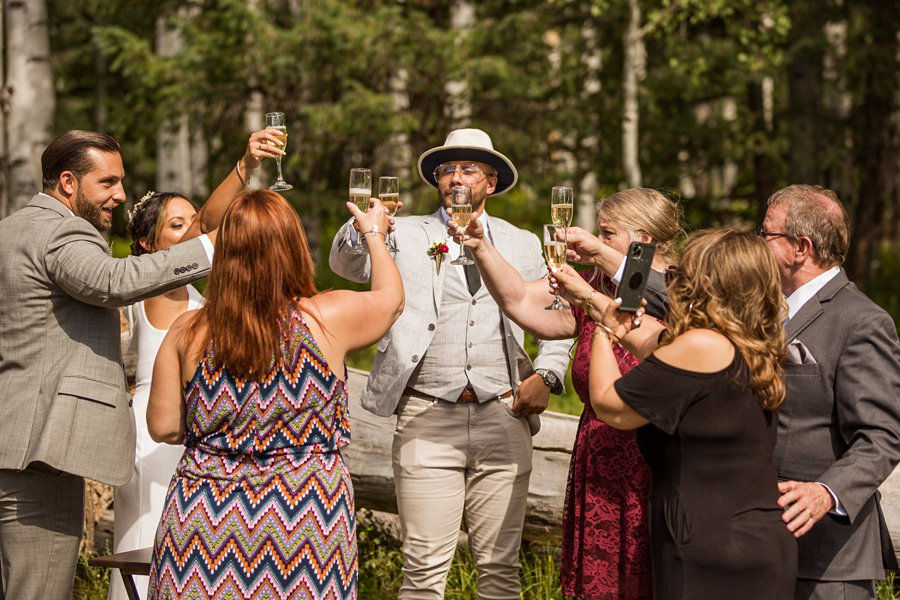 Jeanne-Marie and Rami: Arizona Mountains Wedding toast and cheers and celebration