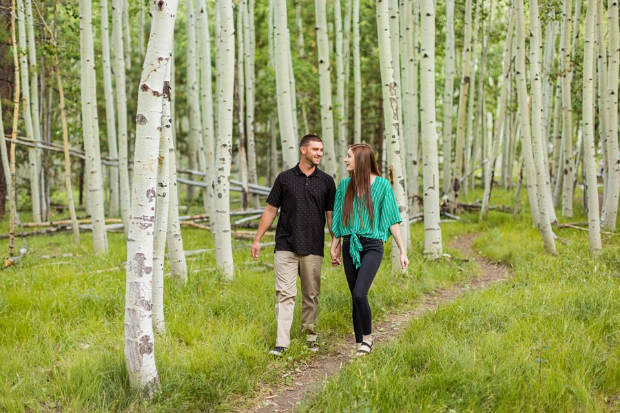 Taylor and Kevin: Lockett Meadow Engagement Session walking in the forest together
