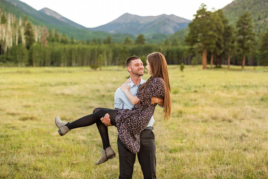 Taylor and Kevin: Flagstaff Arizona Portrait Photography cuddling in the meadow