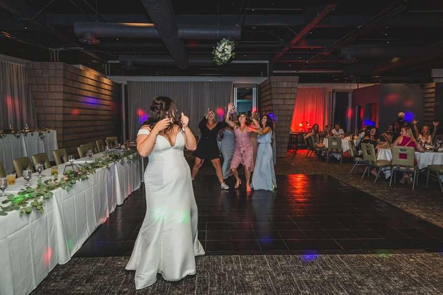 Leah and Trenten: Scottsdale Elopement Photographers bouquet toss