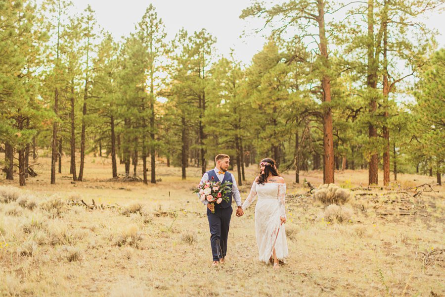 Lexi and Garrett: Northern Arizona Elopements couple walking in forest