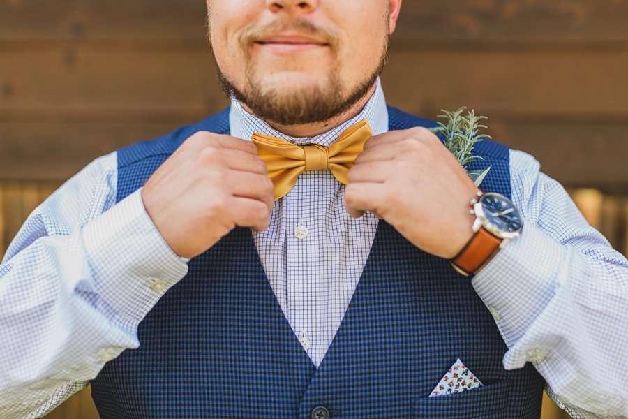 Lexi and Garrett: Flagstaff Meadow Mountain Wedding adjusting his tie