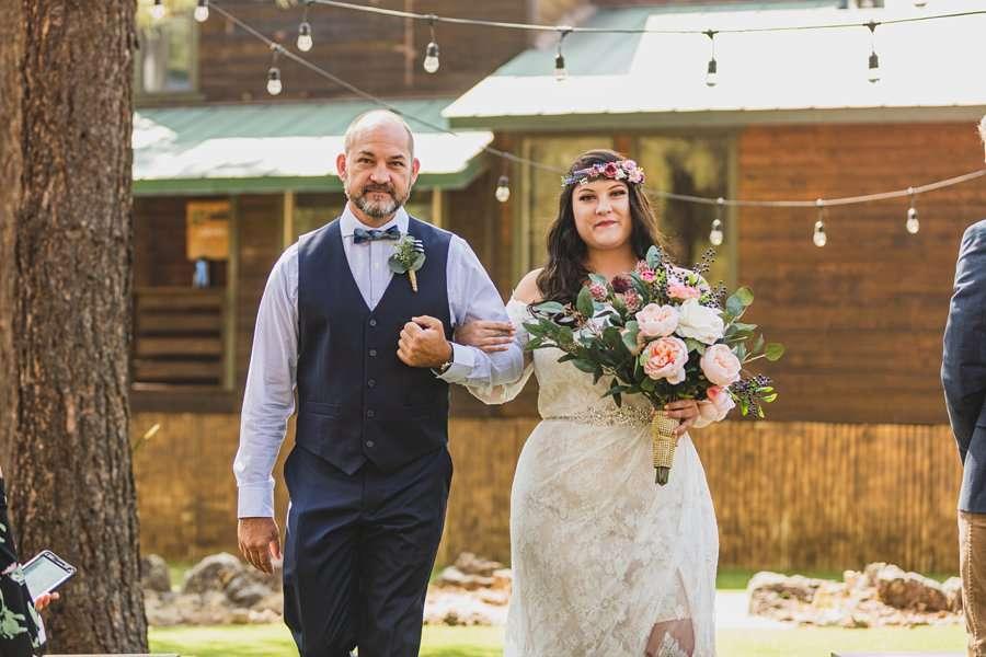 Lexi and Garrett: Flagstaff Meadow Mountain Wedding bride walking down the asile