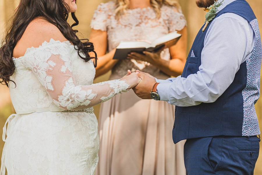 Lexi and Garrett: Northern Arizona Wedding Venues holding hands