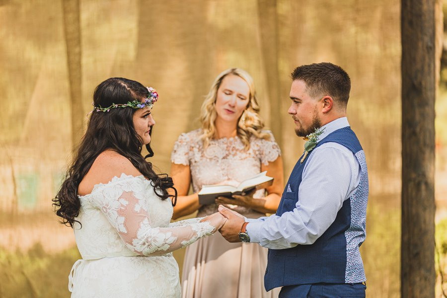 Lexi and Garrett: Northern Arizona Wedding Venues exchanging rings