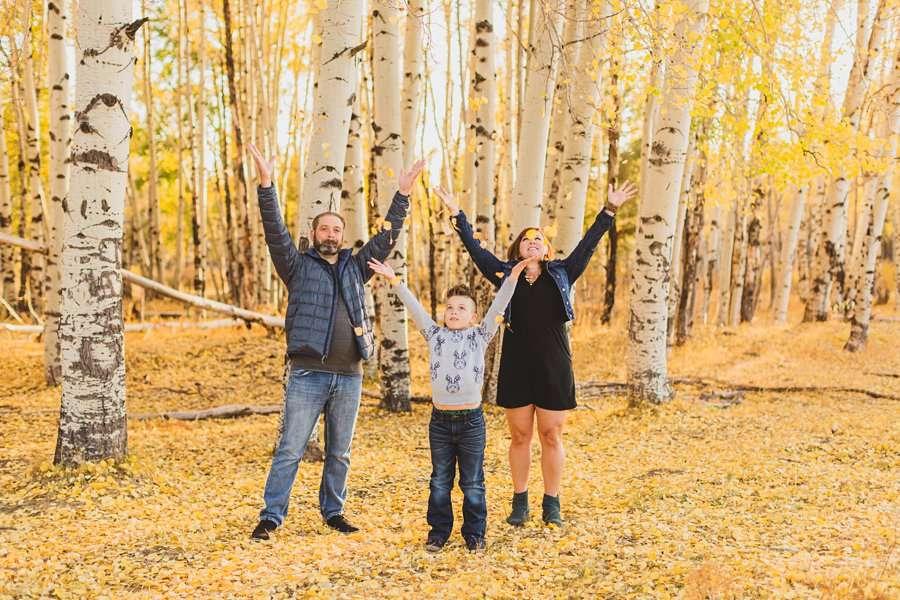 Hauser Family: Flagstaff Aspen Portrait Photographers throwing leaves