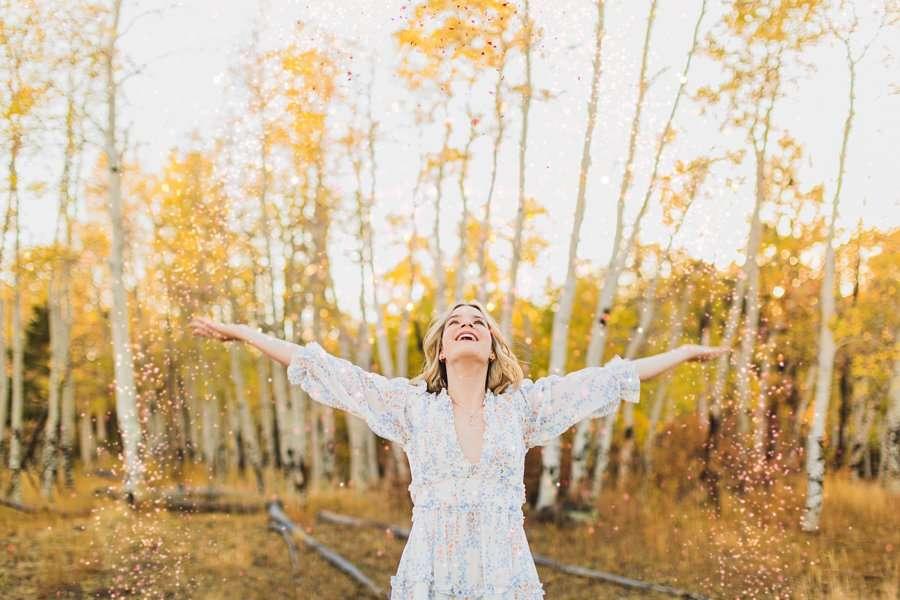 Kaia: Senior Photography Northern Arizona throwing leaves