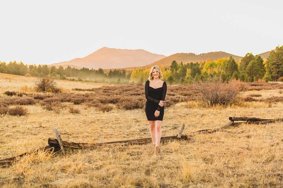 Kaia: Graduation Session Photographers Flagstaff in meadow