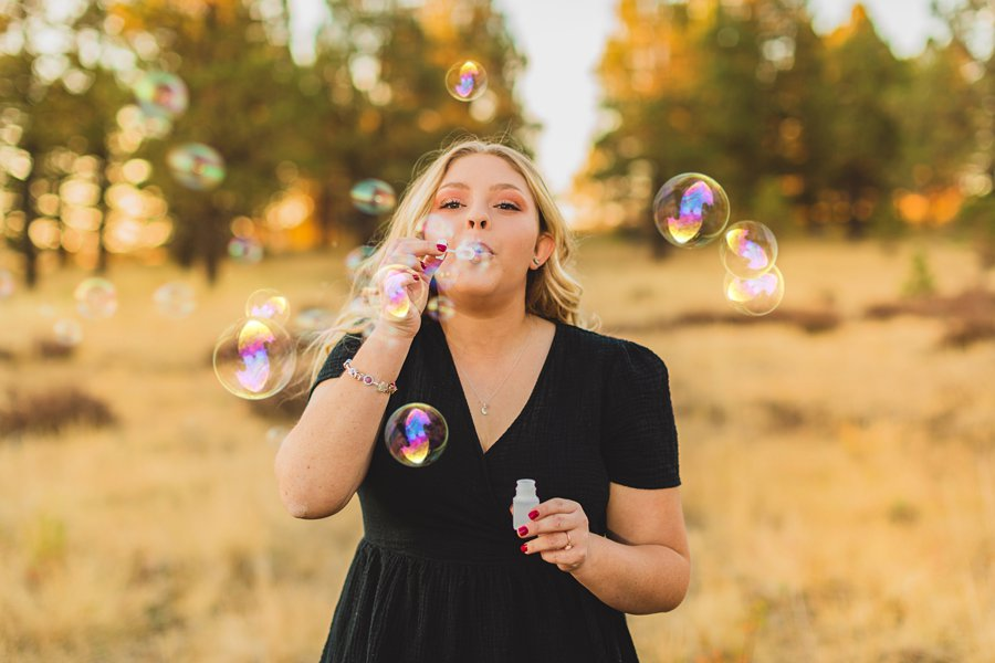 Layne and Sophie: Northern Arizona Fall Photography blowing bubbles