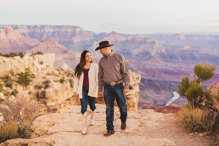 Yesenia and Justin: Grand Canyon Engagement Photographers walking together