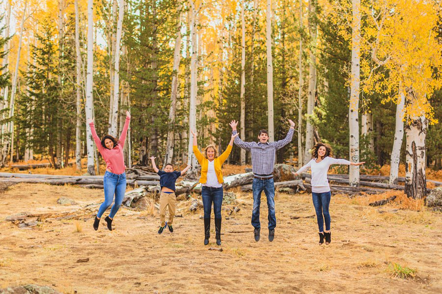 Barrett Family: Aspens Flagstaff Portrait Photographers jumping together
