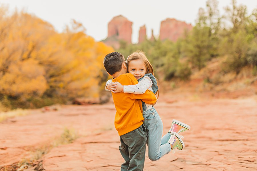 Serrano Family: Red Rock Crossing Portraits brother sister hugs