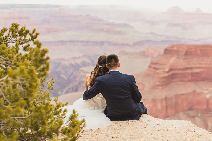 Ashlynn and Jacob: Elopement Photographers Grand Canyon sitting together