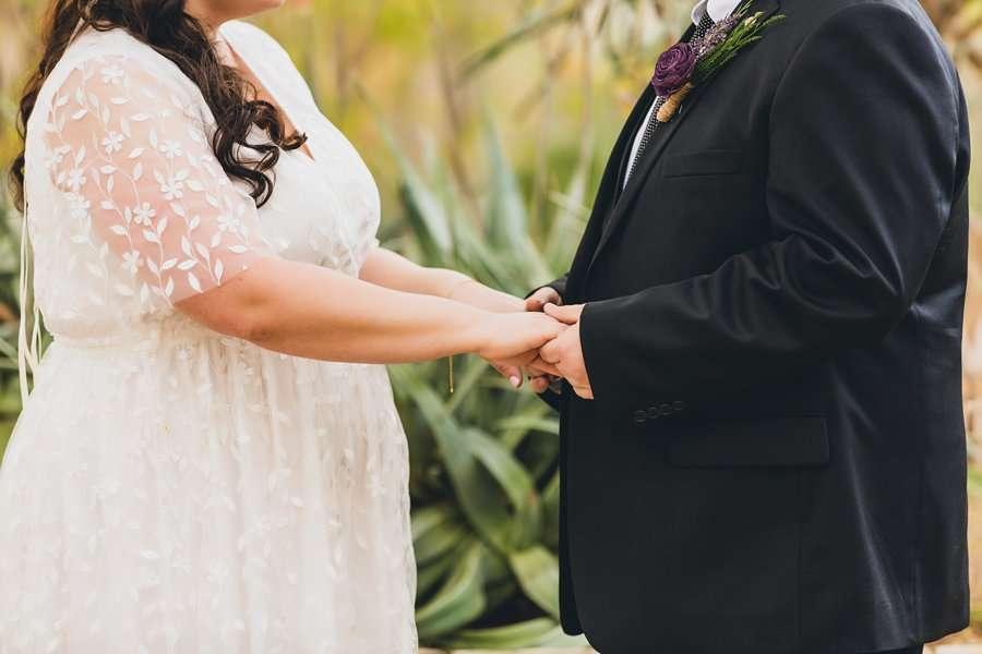Shawna and Jason: Desert Botanical Garden Elopement holding hands