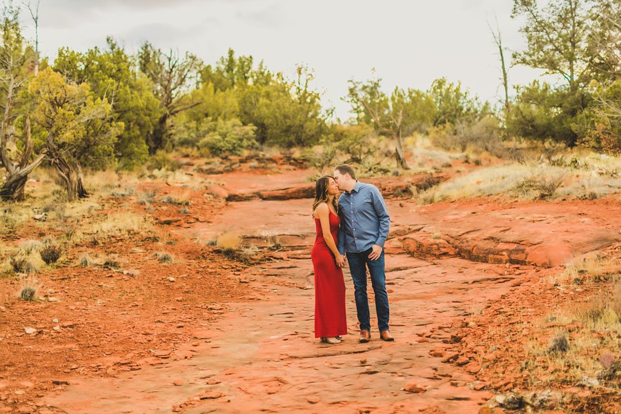 Kimber and Robb: Red Rock Arizona Portraits kissing together