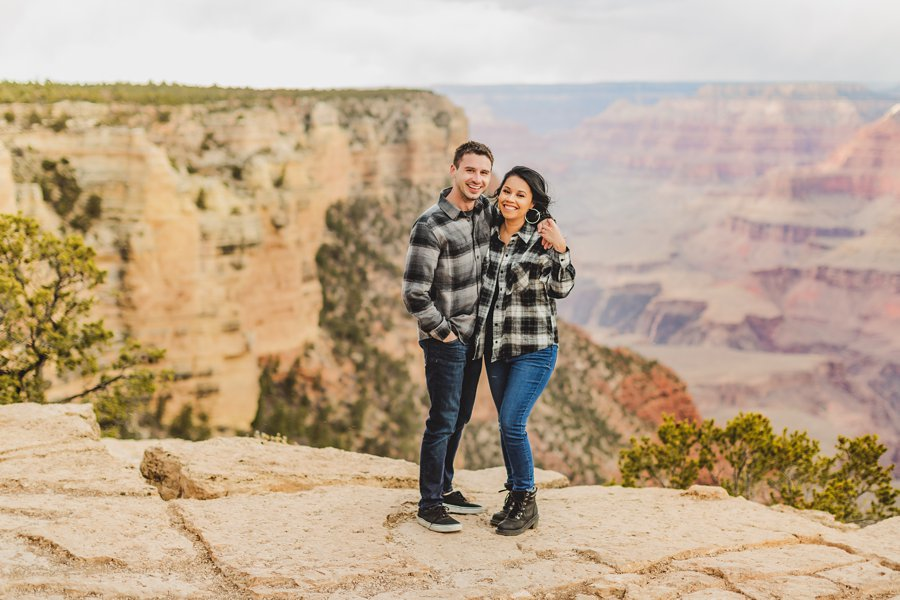 Cristina and Cody: Engagement Photographer Grand Canyon him and her on the edge