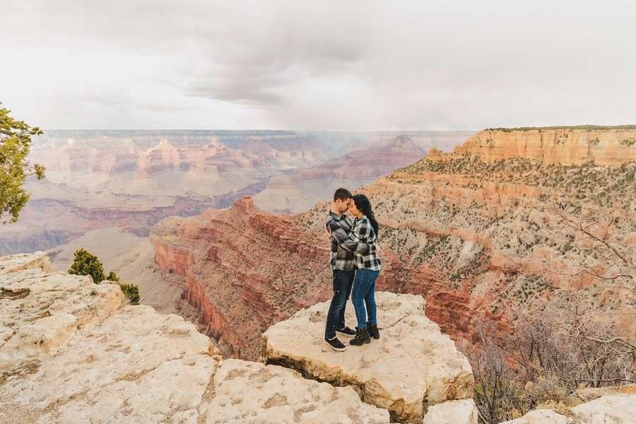 Cristina and Cody: Engagement Photographer Grand Canyon couple cuddling